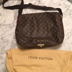 Louis Vuitton Messenger bag with dust cover.